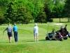 bigstockphoto_seniors_golfing_655417