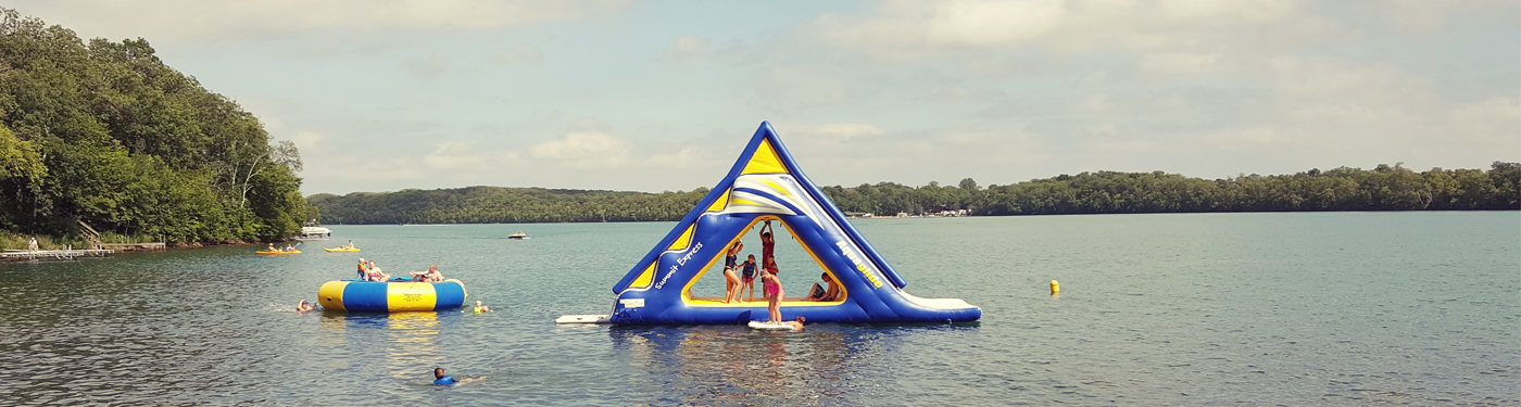 Image of MN fractional cabin ownership kids playing on water toys